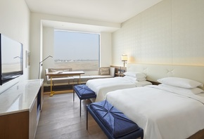 -Andaz-Twin-Beds-With-Runway-View-_Andaz-Delhi-A-Concept-By-Hyatt_Treniq_0